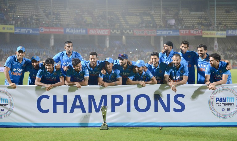 Indian cricket team pose with paytm T20 champions Trophy during the third T20 international match between India and Sri Lanka at the Dr. Y.S. Rajasekhara Reddy ACA-VDCA Cricket Stadium in Visakhapatnam on February 14, 2016. India won the series with 2-1. / AFP / NOAH SEELAM
