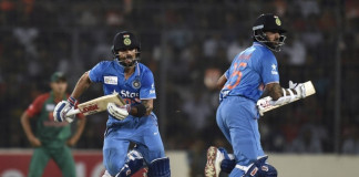 Indian cricketer Virat Kohli (L) and Shikhar Dhawan (R) run between the wickets during the Asia Cup T20 cricket tournament final match between Bangladesh and India at the Sher-e-Bangla National Cricket Stadium in Dhaka on March 6, 2016. / AFP / MUNIR UZ ZAMAN