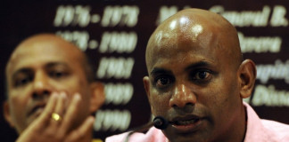 """Sri Lanka's new chief cricket selector Sanath Jayasuriya (R) and fellow selection panel member, former Sri Lankan cricket captain Hashan Thilakarathna (L) speak to reporters in Colombo on January 30, 2013. Jayasuriya, who is also a ruling party member of parliament, said he wants to ensure more """"passion for the game"""" among players in the national team. AFP PHOTO/ LAKRUWAN WANNIARACHCHI / AFP PHOTO / LAKRUWAN WANNIARACHCHI"""