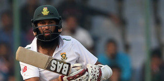 South Africa's captain Hashim Amla looks at the ball after playing a shot during the fourth day of the fourth Test cricket match between India and South Africa ©AFP