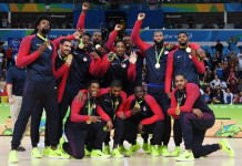 Gold medallists USA's forward Jimmy Butler, USA's guard Kevin Durant, USA's centre DeAndre Jordan, USA's guard Kyle Lowry, USA's forward Harrison Barnes, USA's guard Demar Derozan, USA's guard Kyrie Irving, USA's guard Klay Thompson, USA's centre DeMarcus Cousins, USA's guard Paul George, USA's forward Draymond Green and USA's forward Carmelo Anthony pose after the final of the Men's basketball competition at the Carioca Arena 1 in Rio de Janeiro on August 21, 2016 during the Rio 2016 Olympic Games. / AFP PHOTO / Mark RALSTON