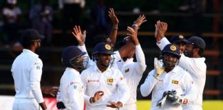 This match marked Zimbabwe's 100th cricket match since their debut in 1992. / AFP PHOTO / Jekesai Njikizana