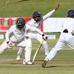 Sri Lanka players appeal for th wicket of Tiinotenda Mawoyo during the second day of the second cricket Test match between Sri Lanka and hosts Zimbabwe at the Harare Sports club, on November 7, 2016. / AFP PHOTO / Jekesai Njikizana