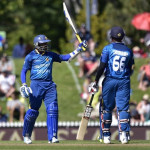 Tillakaratne Dilshan (L) of Sri Lanka celebrates 50 runs with teammate Lahiru Thirimanne during the 3rd One Day International cricket match between New Zealand and Sri Lanka at Saxton Oval in Nelson on December 31, 2015. AFP PHOTO / MARTY MELVILLE / AFP / Marty Melville