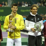 Novak Djokovic (C-L) of Serbia poses for a photo with his winning trophy next to Rafael Nadal (C-R) of Spain holding his second place trophy following the final of the Qatar Open tennis tournament on January 9, 2016, in Doha. AFP PHOTO / KARIM JAAFAR / AFP / KARIM JAAFAR