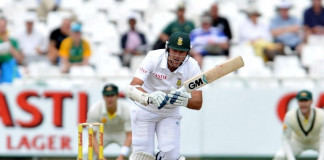 South Africa's cricketer and captain Graeme Smith departs after being bowled by Ryan Harrios of Australia on Day 3 of the third Test match between South Africa and Australia at Newlands on 3 March, 2014. AFP PHOTO / Luigi Bennett / AFP / Luigi Bennett