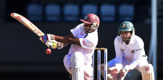 West Indies batsman Shivnarine Chanderpaul connects off a delivery from Bangladesh bowler Taijul Islam as wicket keeper Mushfiqir Rahim closes in on day three of the second and final Test between West Indies and Bangladesh on September 15, 2014 at the Beausejour Cricket Ground in Gros Islet, St Lucia. AFP PHOTO / Frederic J. BROWN / AFP / FREDERIC J. BROWN