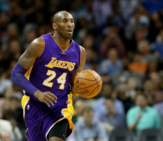 CHARLOTTE, NC - DECEMBER 28: Kobe Bryant #24 of the Los Angeles Lakers brings the ball up the court against the Charlotte Hornets at Time Warner Cable Arena on December 28, 2015 in Charlotte, North Carolina. NOTE TO USER: User expressly acknowledges and agrees that, by downloading and or using this photograph, User is consenting to the terms and conditions of the Getty Images License Agreement. Streeter Lecka/Getty Images/AFP