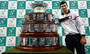 Serbia's Novak Djokovic poses with the Davis Cup trophy, post draw, before their tie against the might Czech Republic in 2013. Photo Credits : AFP
