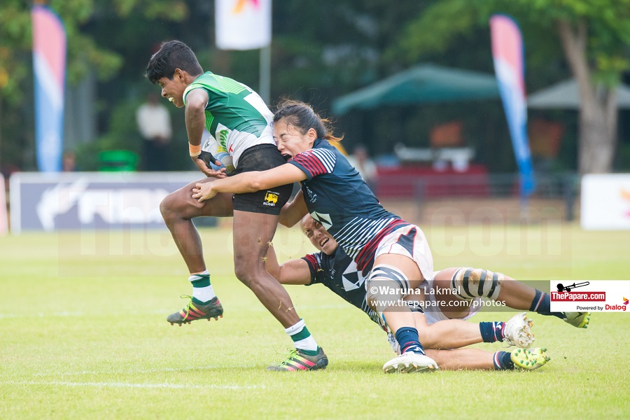 Sri Lanka's Dulani Pallikondage is taken down by the Hong Kong defense