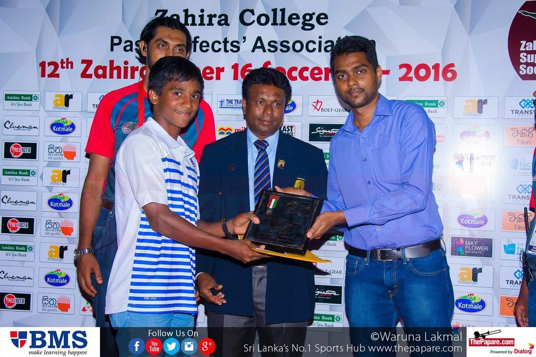 12th Zahira Super 16 Soccer 7's 2016 - Zahira College Grounds - 08/10/2016 Maris Stella captain Anjana Gunawardena collects the Shield championship trophy.
