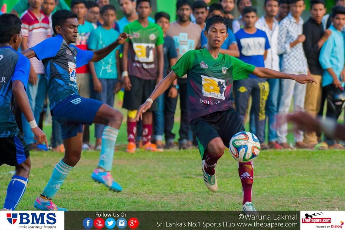 12th Zahira Super 16 Soccer 7's 2016 - Zahira College Grounds - 08/10/2016 Shafran Sathar (R) about to take a shot while Weslyan defender (L) tries to block it.