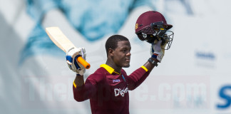 Carlos Brathwaite raises his bat after making a stunning century