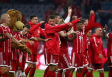 Bayern Munich players celebrate at the end of the match by michael dalder