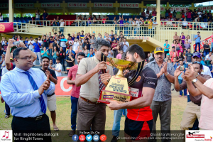 University of Peradeniya rugby captain Udara Kasthuriarachchi receiving the winning trophy