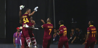 Lendl Simmons is hoisted by his team-mates