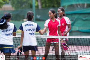 Ladies College 2nd Doubles players shake hands with the Visakha