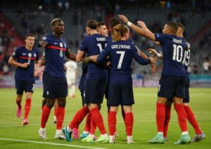 French players celebrating agoal