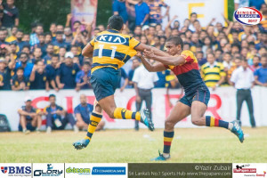 Sabith Feroze fends off Amith Kulathunga his opposite number