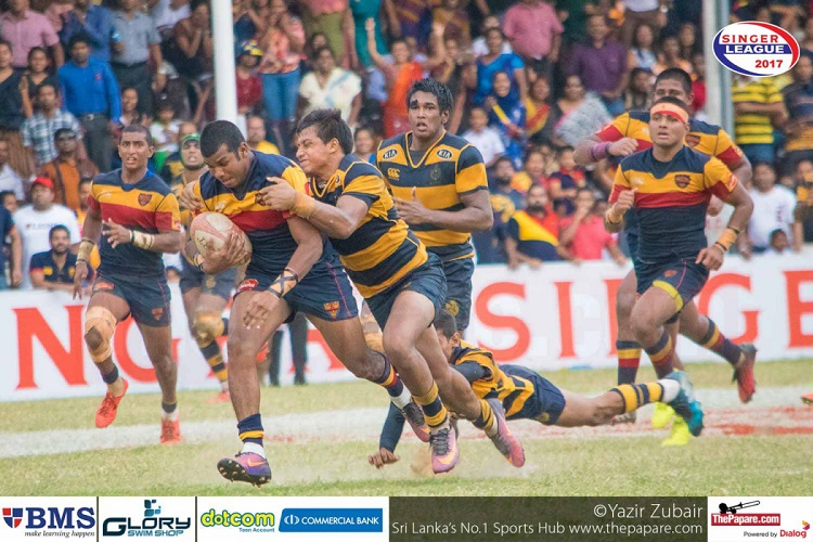 Akith Sakalasuriya tackled by Thulaib Hassen
