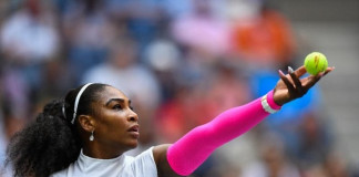 Serena Williams of the US serves to Yaroslava Shvedova of Kazakhstan during their US Open fourth round match,