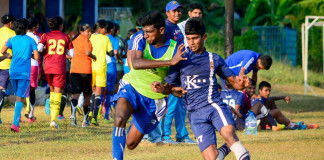 A Kingswood and a Josephian player tussling for the ball