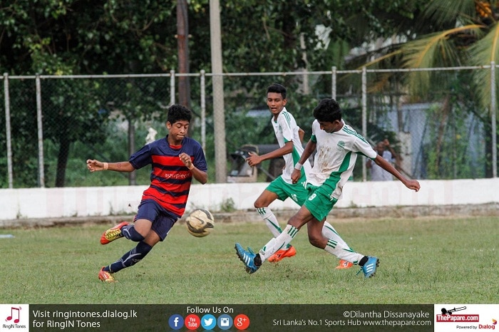 Abishek Fernando (R) of St.Benedict's College shoots to score a goal - Schools Football 2016