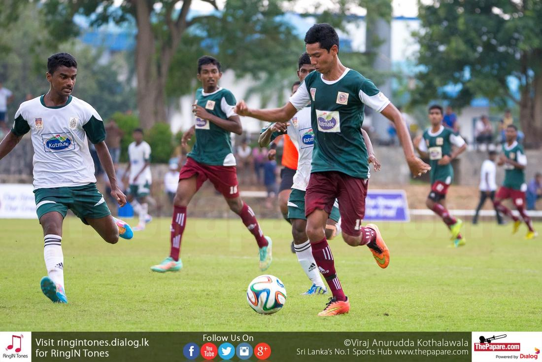 Ahamed Shakeer of Zahira College brings the ball forward for an attack.