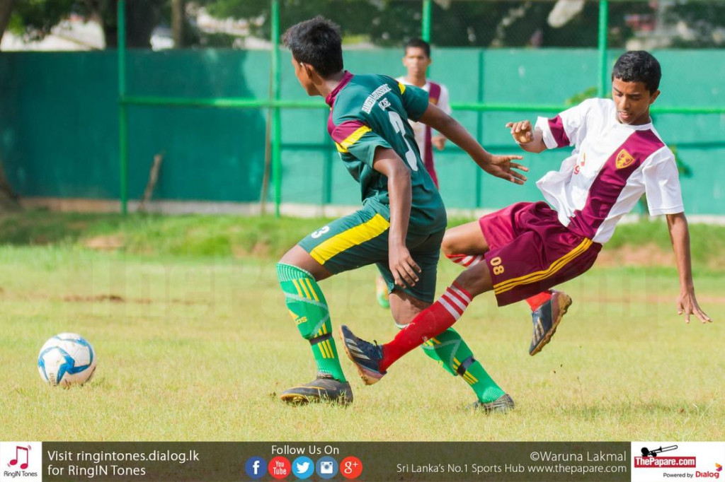 Ananda College player (R) puts in a tackle on a Hameed Al Husseinie player (L) - Schools Football 2016