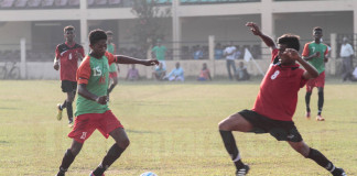 Beruwala League U19 player lunges forward to make a tackle