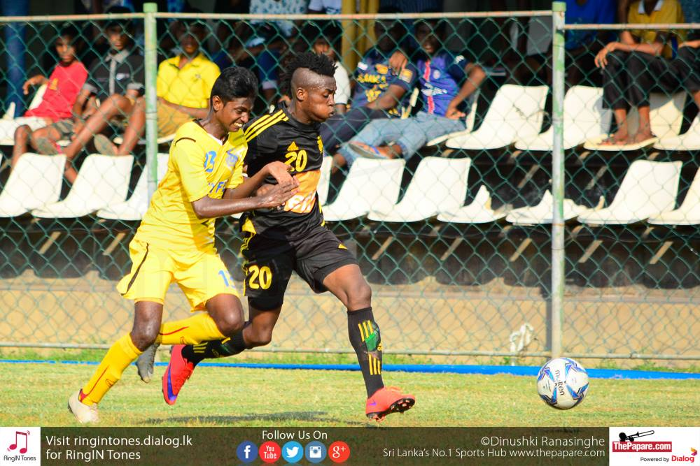 Bodrie Dimitri (R) tussling for the ball with Suntharaj Niresh (L) in the City FL President's Trophy