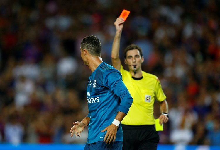 Cristiano Ronaldo is shown a red card by referee Ricardo de Burgos Bengoetxea after receiving a second yellow card for simulation   REUTERS/Juan Medina