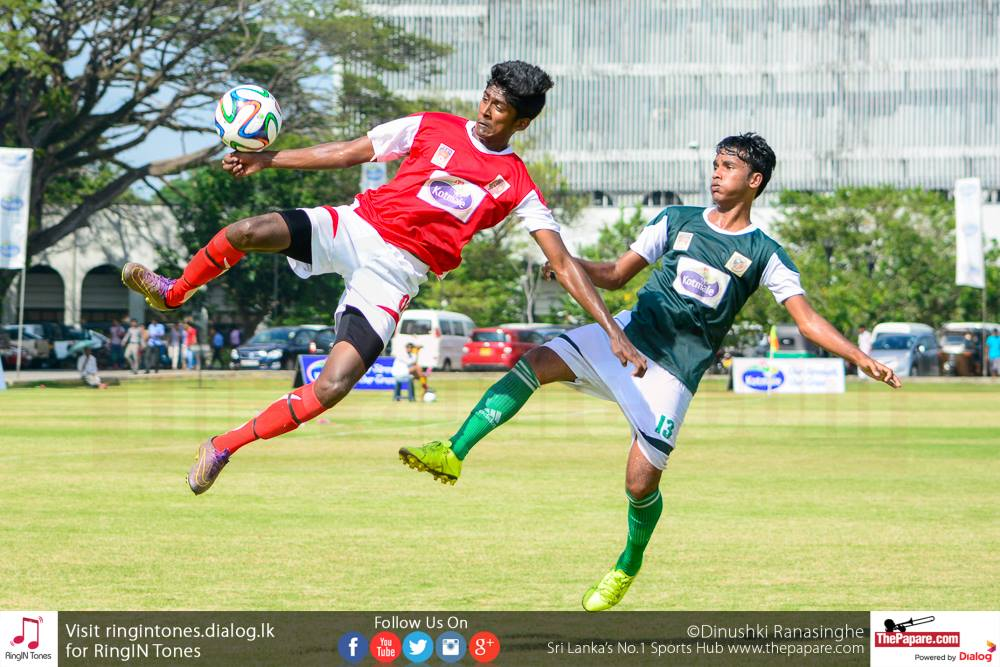 Farood Faiz (R) and a St.Sebastian's player in mid air tussling for the ball. (1)