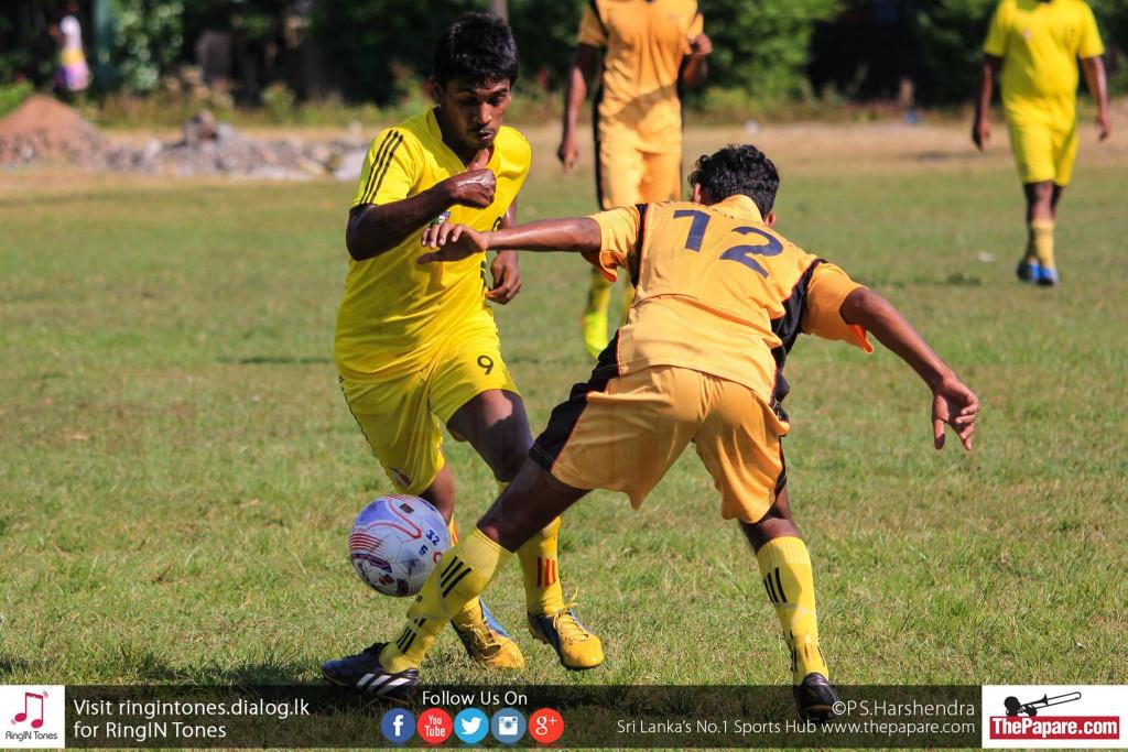 Friends SC player goes past Madushanka.