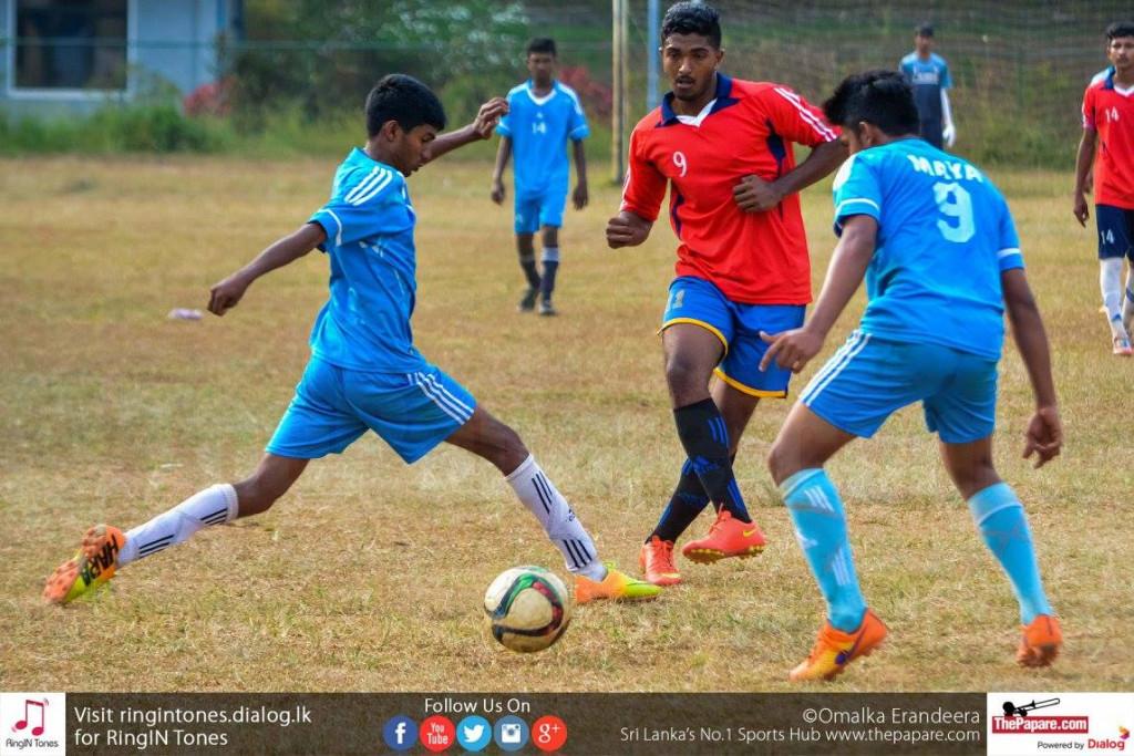 Gampola FL U19 player takes a shot on goal