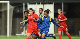 Goalscorer Praveen Maduki dribbles past a Singapore player (Photo - Football Association of Singapore)