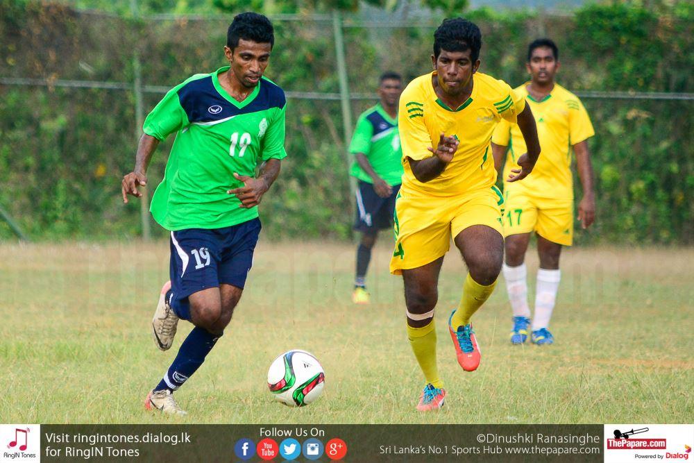 Government Services SC player goes past a Sarasavi SC defender
