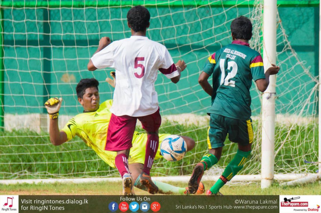 Hameed Al Husseinie Colege player takes a shot at goal - Schools Football 2016