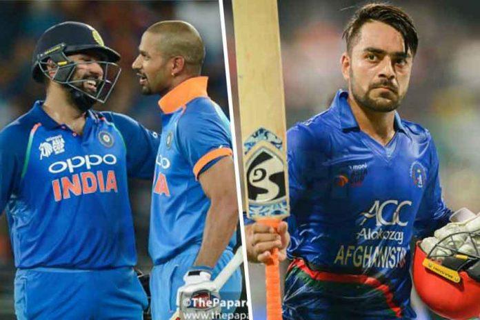 Sharma, Dhawan move up