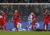 Leicester City's Wes Morgan and Ben Hamer look dejected after FC Porto's third goal
