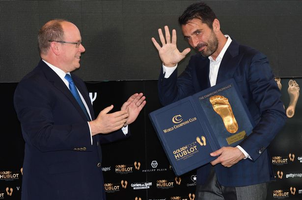 Monaco's Prince Albert II presents Buffon with his award