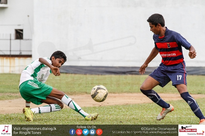 Jerold Meloginus (L) of St.Benedict's makes a tackle on H.K.C.Ishara (R) of Kingswood College to stop an attack - Schools Football 2016