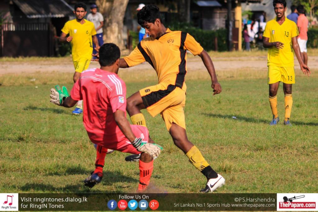 K.P.De Silva of Rathmalana United scores past Friends FC goalkeeper Mohamed Fazil