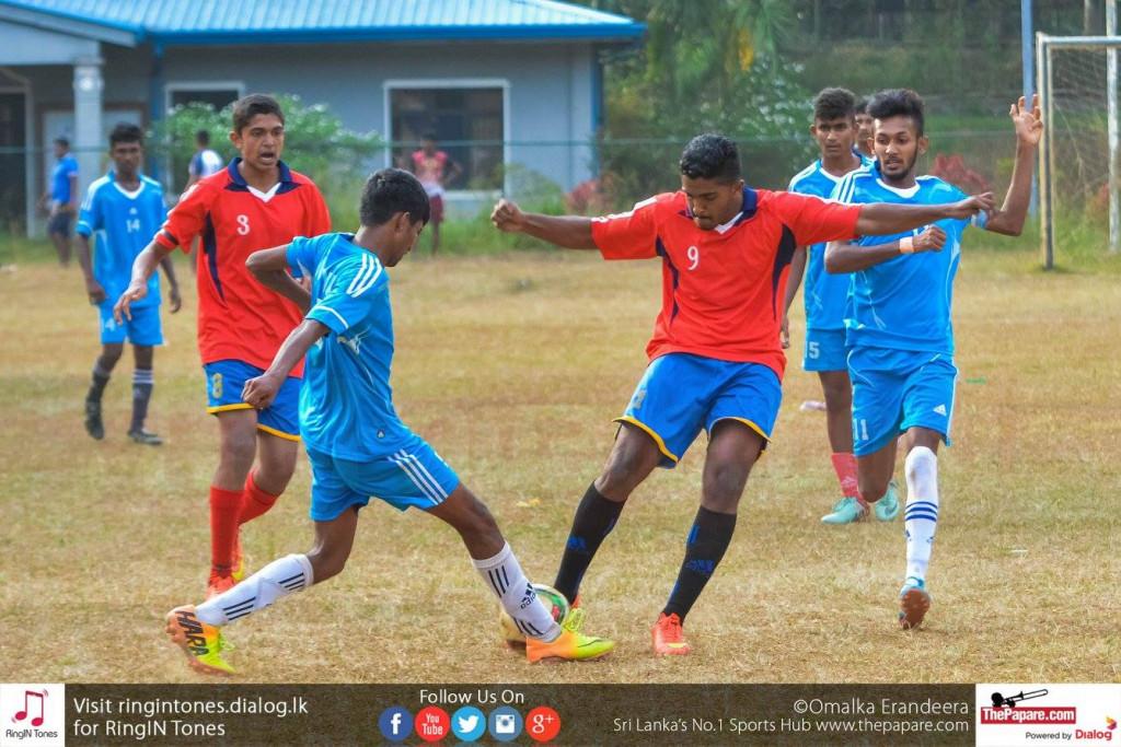 Kegalle FL U19 player puts in a crunching tackle on a Gampola FL U19 player