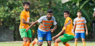 Kirulapone United player (M) wriggles past Edison Figurado and Peshala Malik - FA Cup (Last 32 Round)