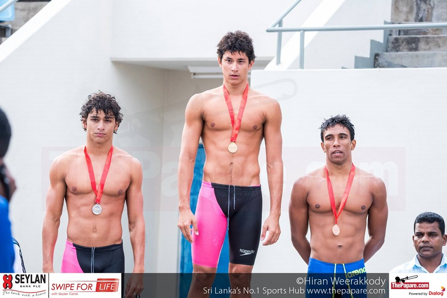 Kyle Abeysinghe Senior Nationals 50m Freestyle Gold Medal Caption:Kyle Abeysinghe (middle) receiving the gold medal for the 50m Freestyle. Also in the photo Shehan De Silva (R) Bronze and Dillon Abeysinghe (L)