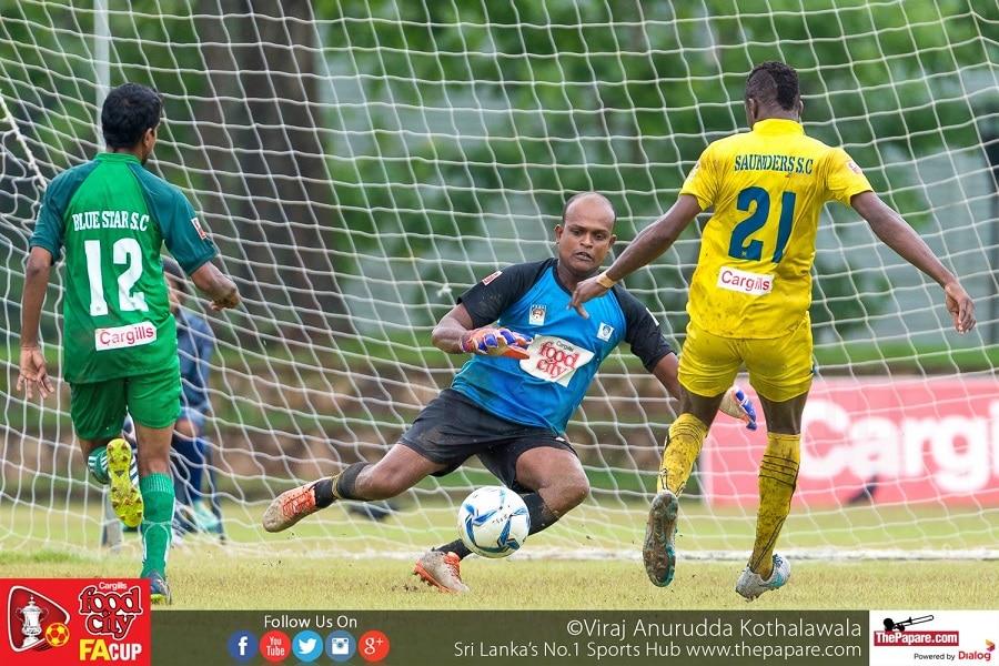 Manjula Fernando (M) makes a save from Traore Mohamed (R) - FA Cup 2016 Quarter Finals