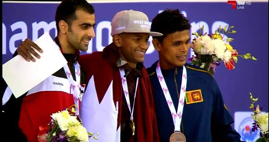 Manjula Kumara (R) on the winners podium - 7th Asian Indoor Athletics Championships.