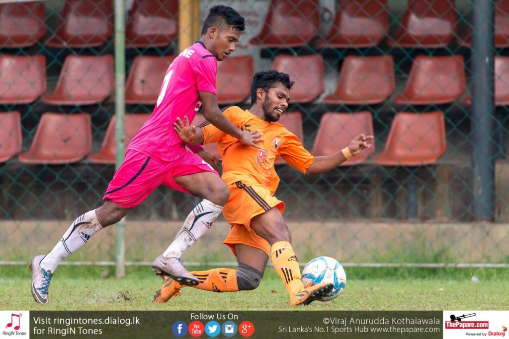 Matara City player (R) puts in a tackle on Afam Akram (L) - FA Cup Pre Quarter Final