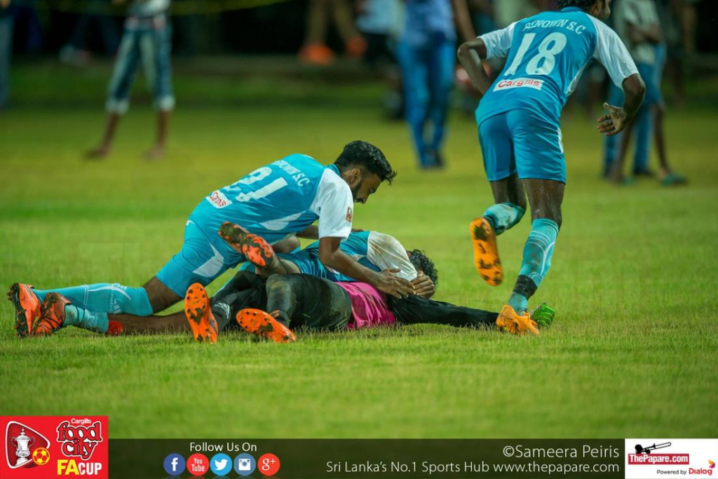 Mohamed Uzman is mobbed in celebration by his Renown teammates after they won the penalty shootout - FA Cup 2016 Semi Final